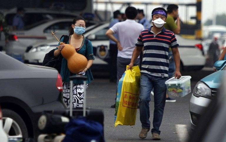 China: Fuerte lluvia en Tianjin aumenta temores de contaminación tras explosiones