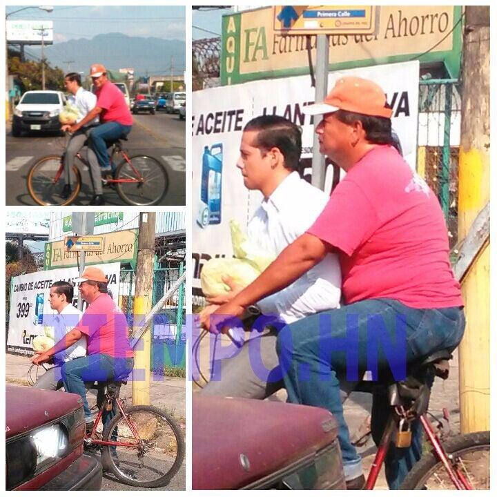 En SPS: Padre lleva a su hijo en bicicleta al trabajo