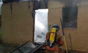 Casa incendiada este día en El Progreso, Yoro
