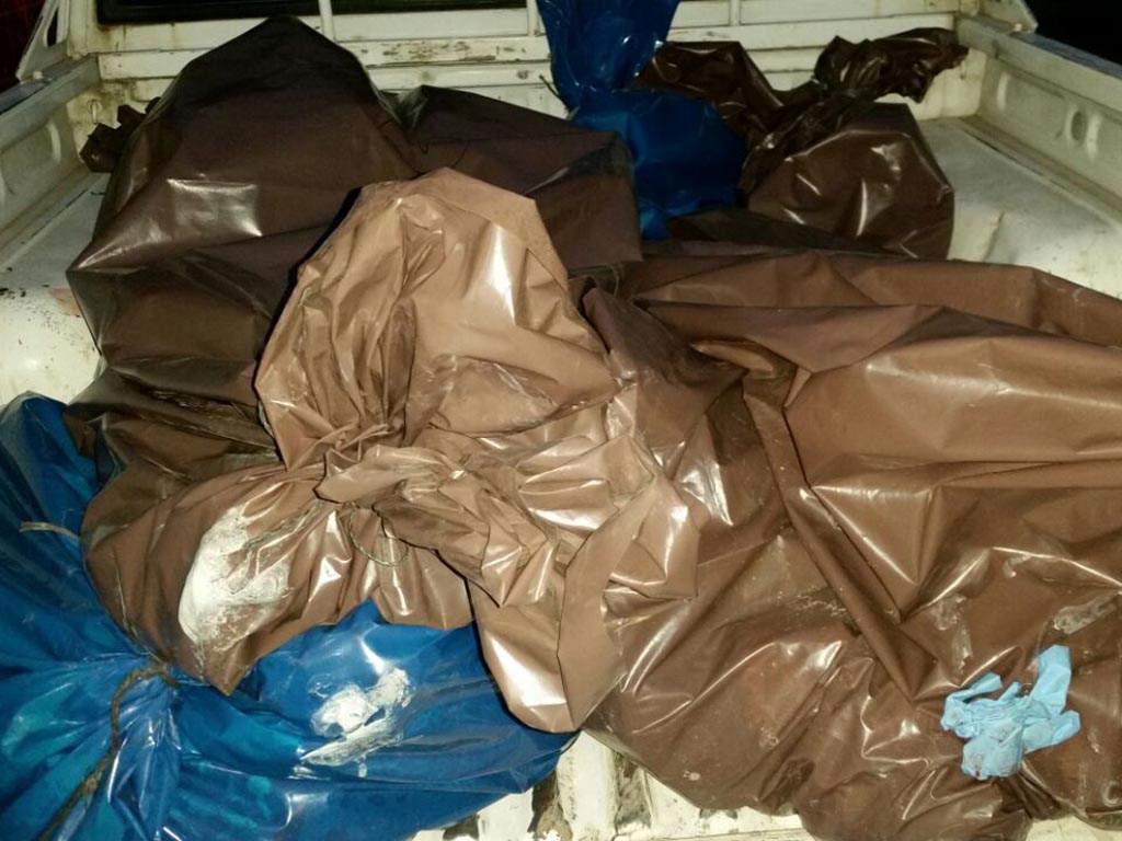 Cuerpos embolsados de las víctimas de masacre en Santa Rita