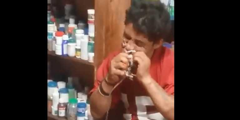 Indigente es captado comiendo una rata en mercado de Comayagua