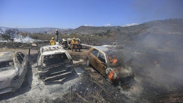 vehículos quemados en la DPI
