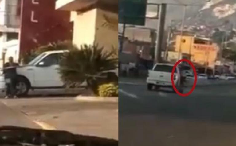 Lo atrapan saliendo de motel y mujer se cuelga de puerta de su carro