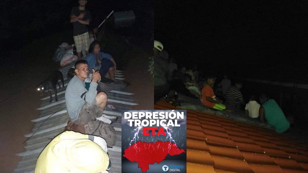 hondureños en el techo