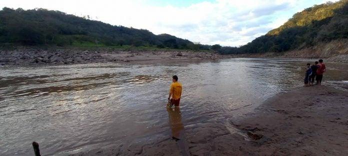 niño arrastrado por río Ulúa