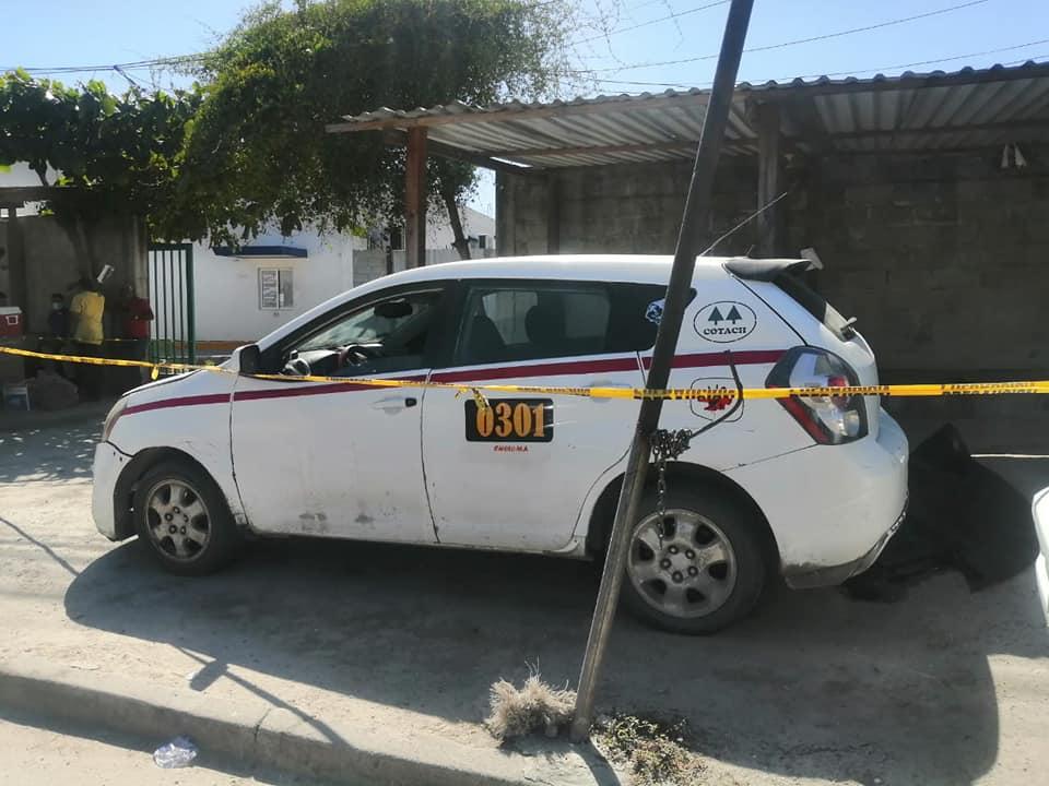 La unidad de taxi donde laboraba la víctima.