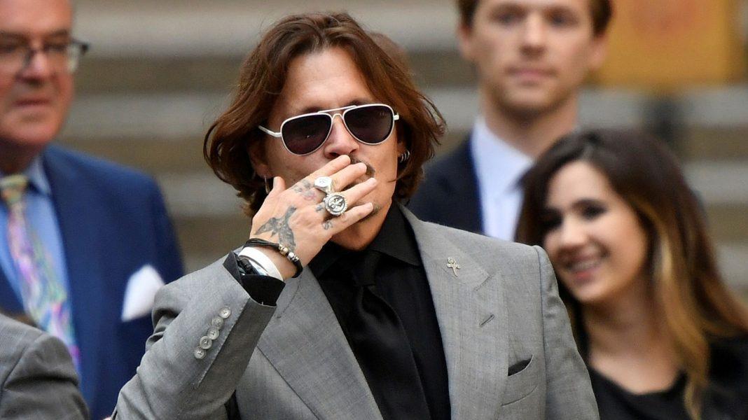 Johnny Depp gana demanda